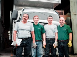 workers standing in front of commercial vehicle